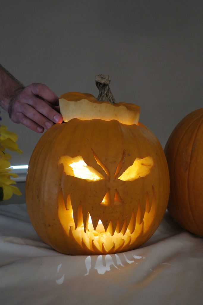 The winning jack-o-lantern is carved to look scary with sharp teeth.