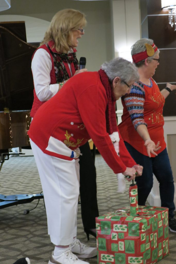 Three women playing a game at Christmas.