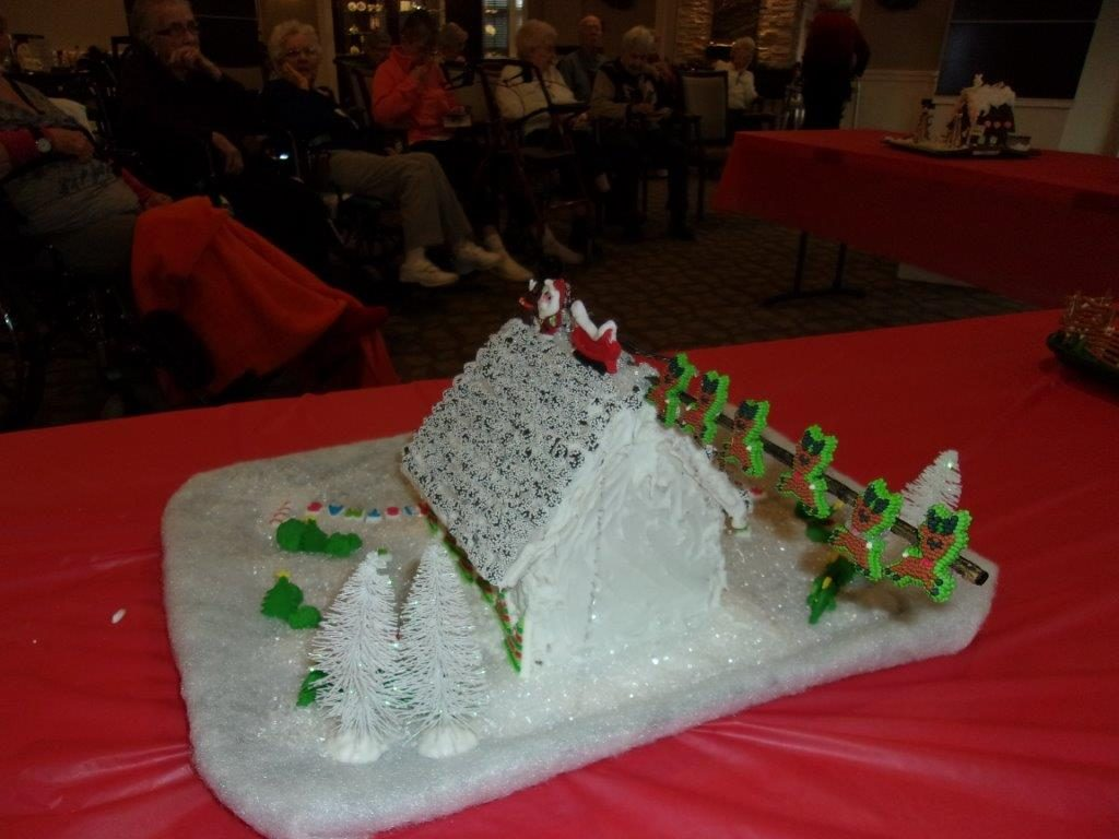 A snow-covered gingerbread house.