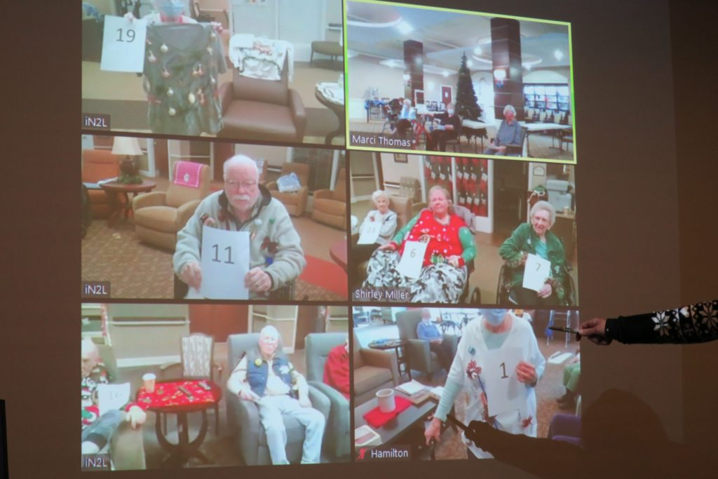 A grid of Zoom screens with everyone in ugly Christmas sweaters.